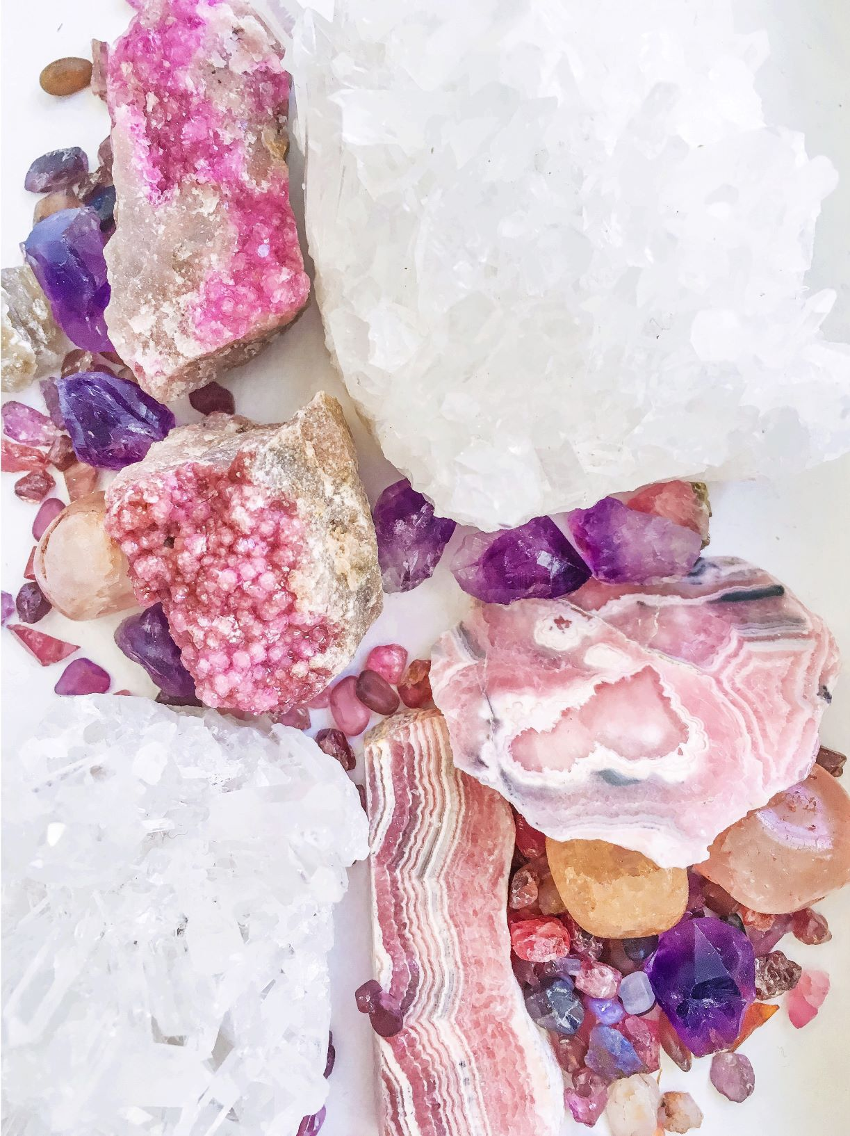 collection-of-pink-and-purple-gems-minerals-and-rocks-on-a-white-background_t20_OoQP08_2MB_comp